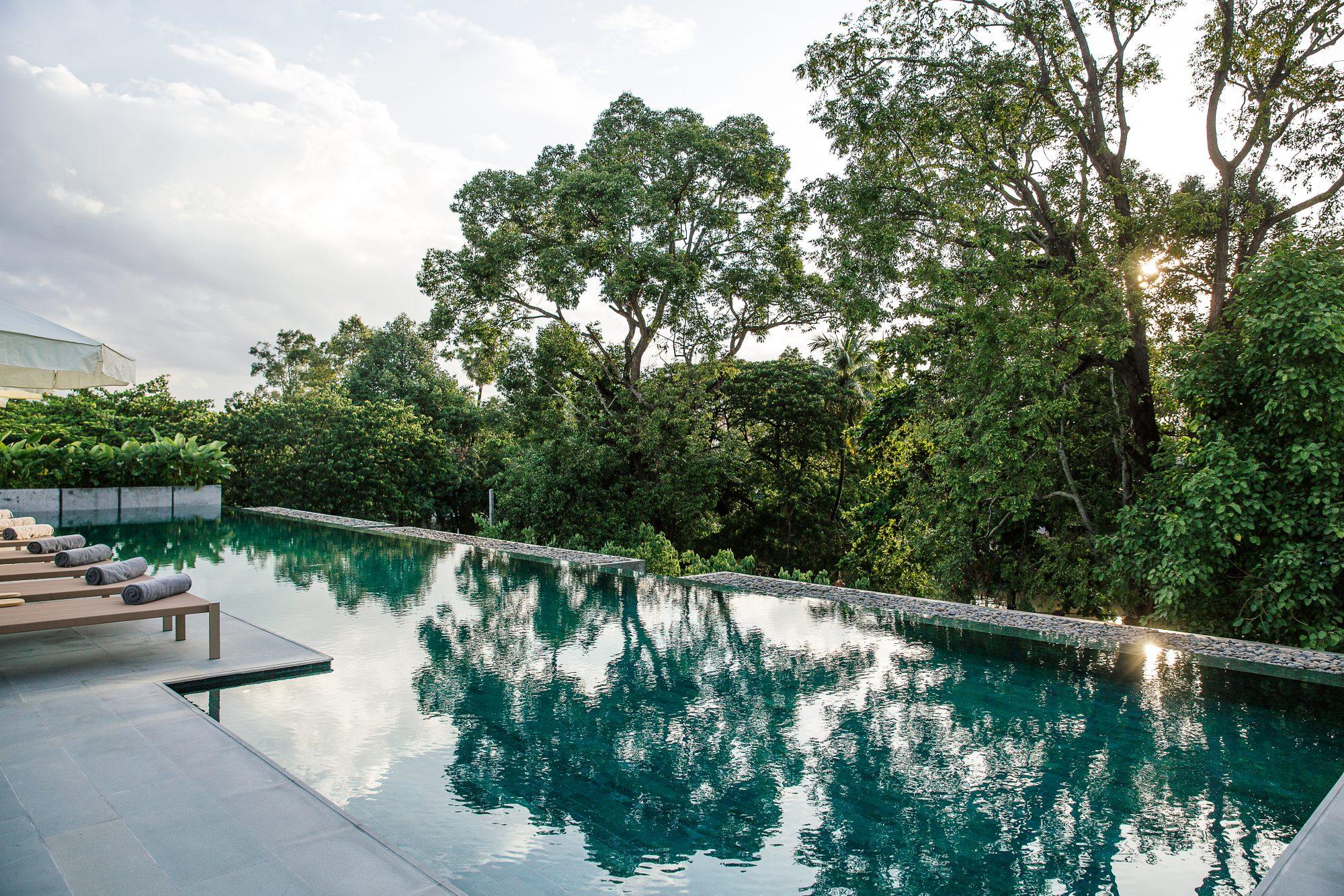 Rooftop pool at Treeline Urban Resort overlooking the Siem Reap River